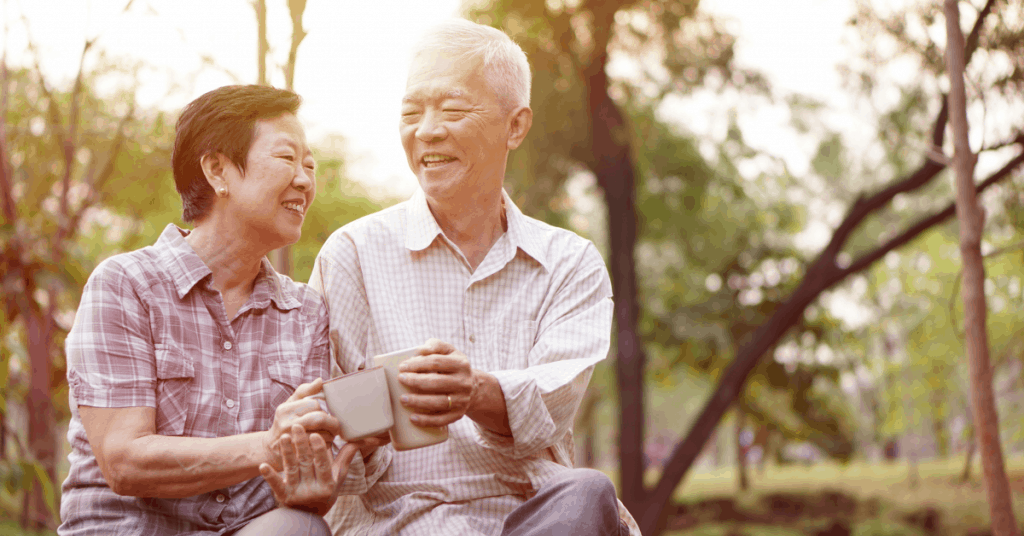 Two older adults enjoying laughter and company.